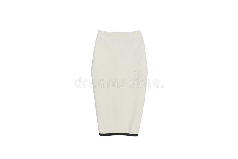 Бежевая юбка на белой предпосылке изолят модная концепция стоковая фотография