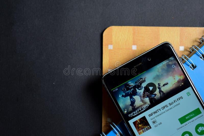 БЕЗГРАНИЧНОСТЬ OPS: Dev app научной фантастики FPS на экране Smartphone стоковая фотография rf