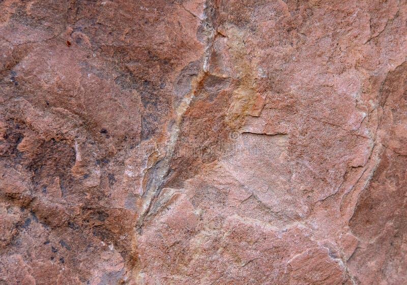Безмолвный фон, текстура неполированного натурального камня, розовый гранит стоковое фото rf