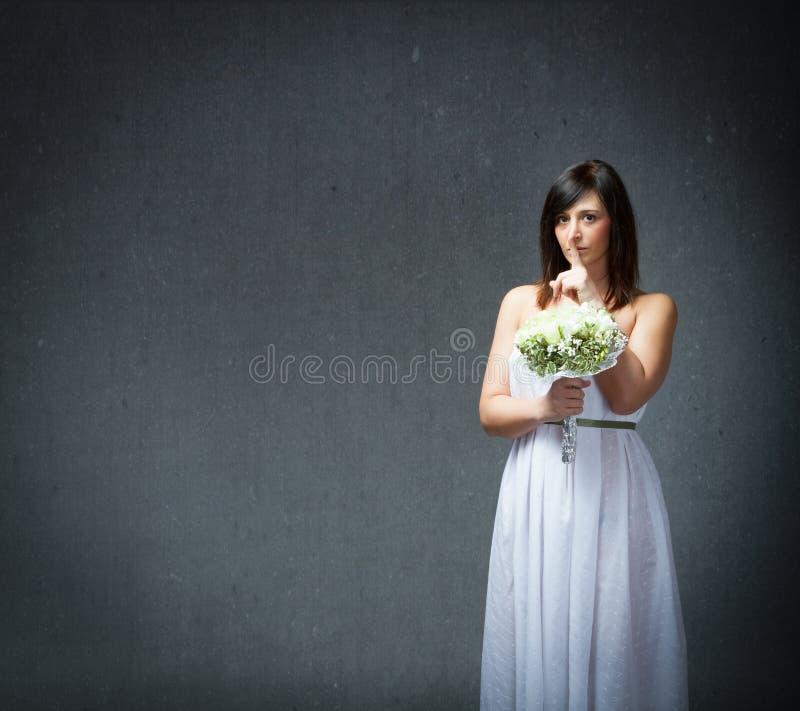 Безмолвие в платье замужества стоковое фото