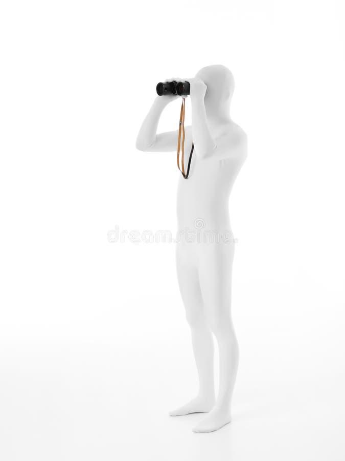 Безликий человек с биноклями стоковые фотографии rf