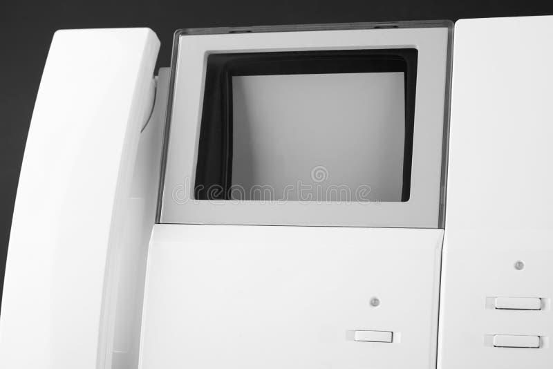 Белая внутренная связь с говоря телефоном стоковые фото