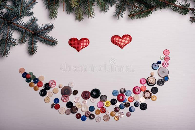 Белая доска с сериями комплекта кнопок вне в улыбке, Valenti стоковое фото