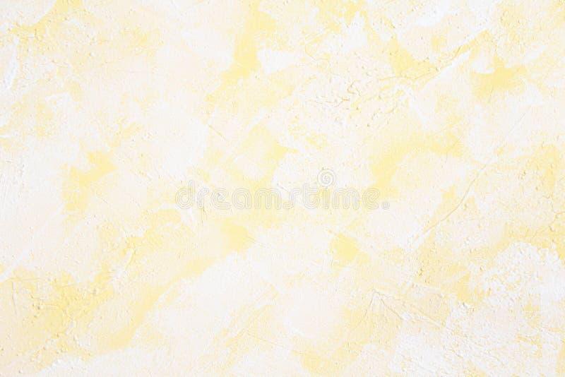 Белая и желтая предпосылка текстуры штукатурки стены Декоративная краска стены стоковая фотография