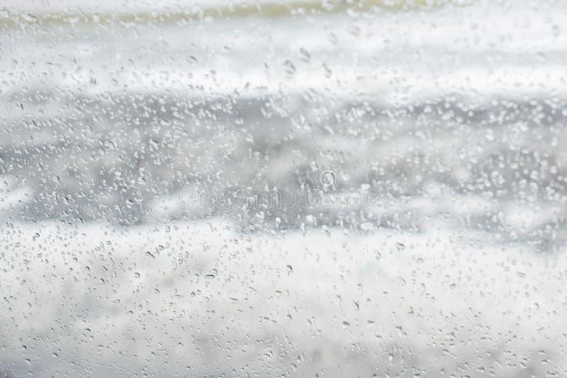 Белая и серая текстура падений bokeh на стекле иллюстрация штока