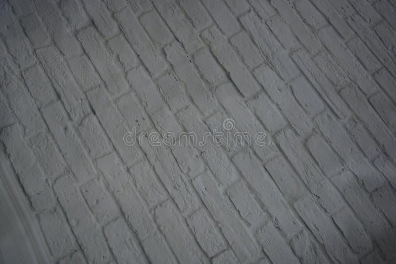 Белая каменная предпосылка светлых кирпичей предусматриванных с слоем белой краски с красивыми томом и текстурой стоковые фото