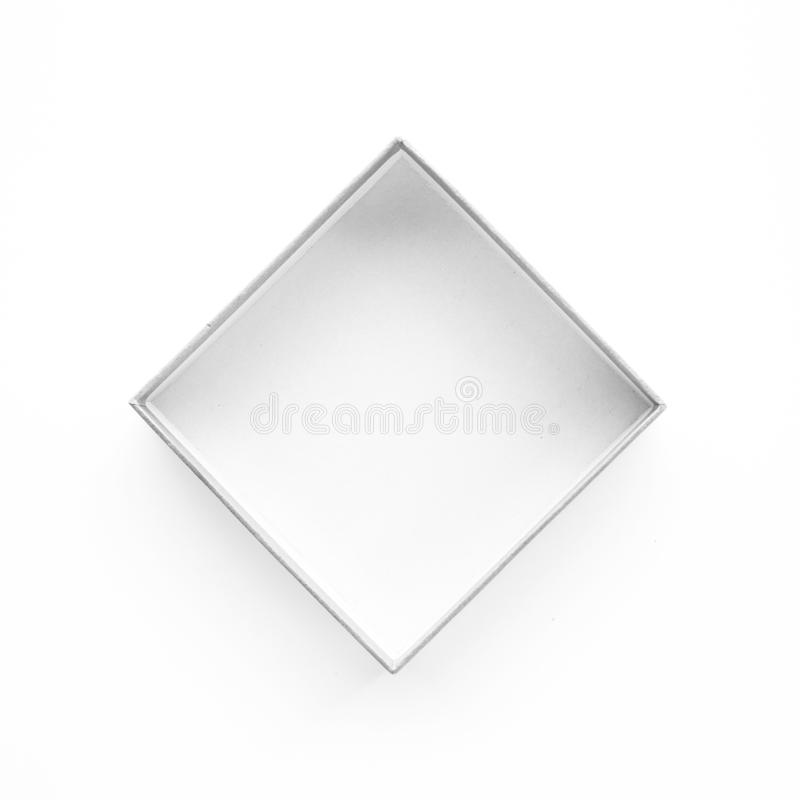 Белая коробка открытая на таблице Взгляд сверху Реальное фото стоковые фотографии rf