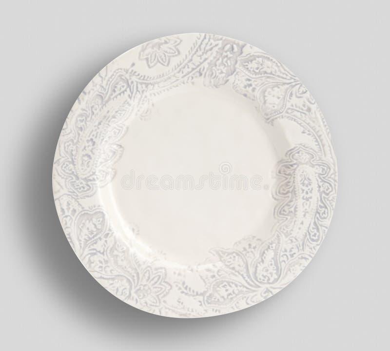 Белая плита на белой поверхности стоковые изображения