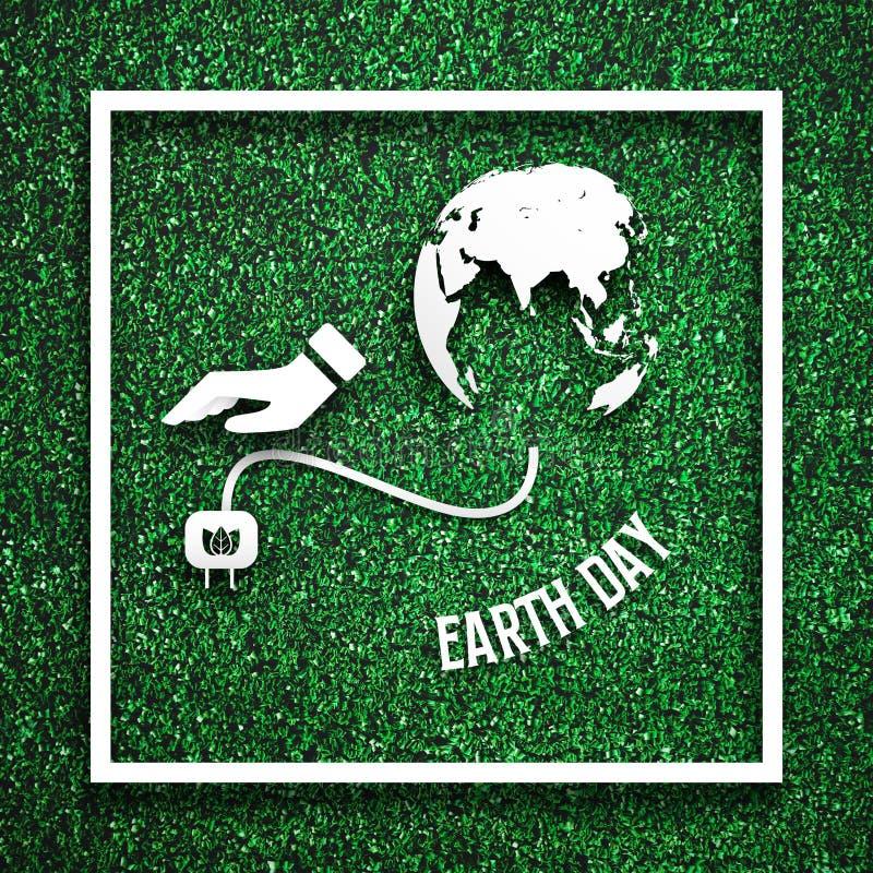 Белая рамка с имеемый отключать от земли как энергосберегающая концепция на зеленой траве для шаблона украшения Eco ? стоковое изображение rf