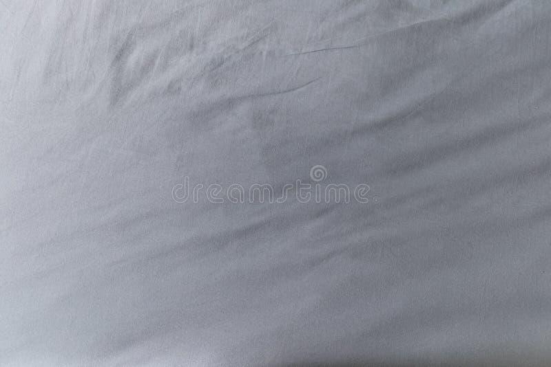Белая текстура простыни Конец-вверх ткани стоковые изображения