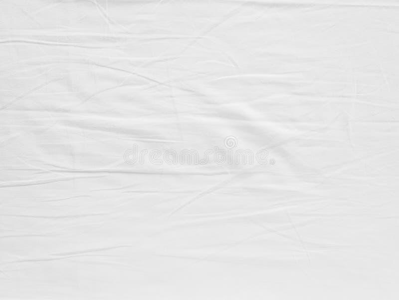 Белая текстура ткани сморщила текстуру, мягкую предпосылка фокуса белую ткань скомканная стоковые изображения