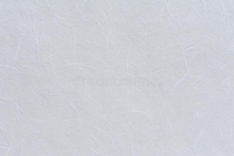 Белая текстурированная бумажная предпосылка стоковое фото