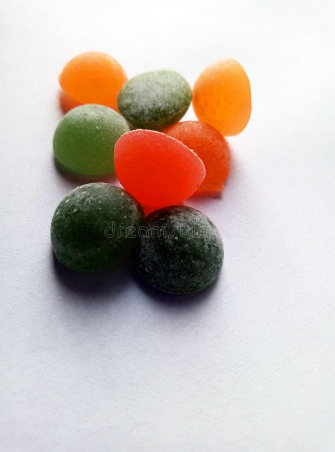 белизна конфеты предпосылки цветастая стоковая фотография