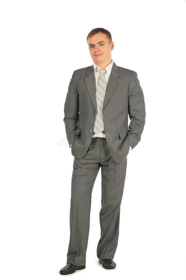 белизна костюма стойки человека предпосылки стоковые изображения rf