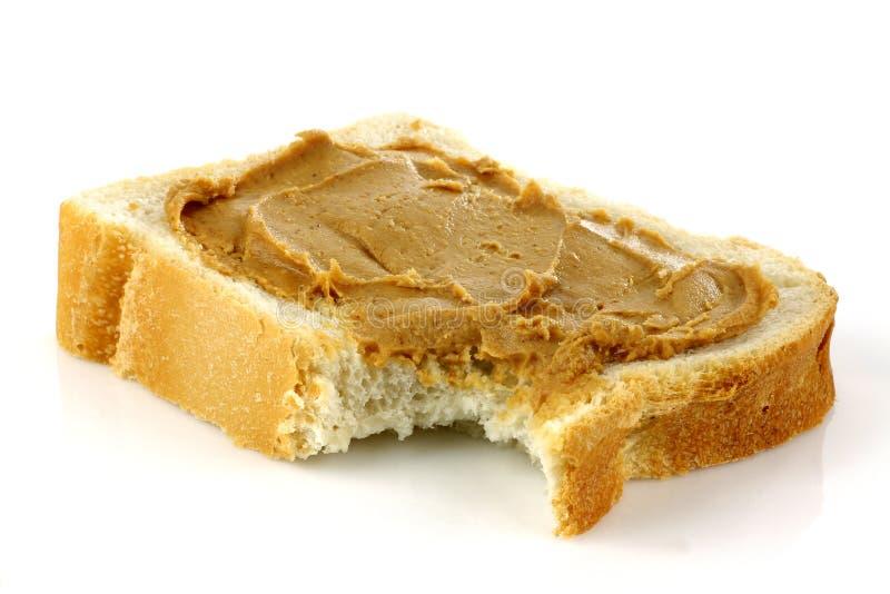 белизна масла хлеба отрезанная арахисом стоковое изображение rf
