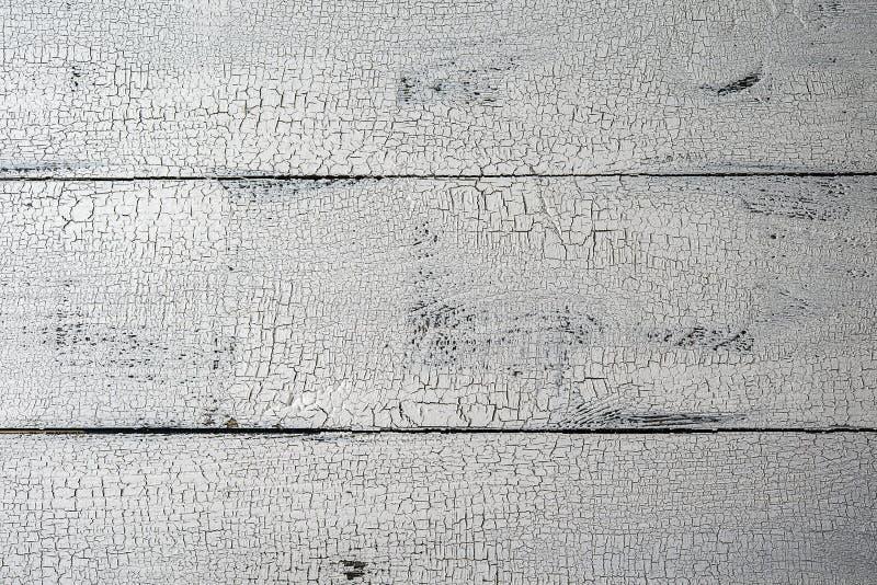 Белизна покрасила естественно достигшую возраста деревянную предпосылку планки стоковая фотография