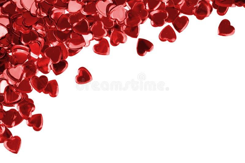 белизна сердец confetti предпосылки красная стоковые фото
