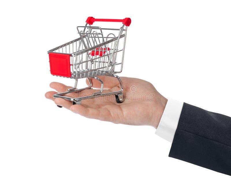 белизна тележки изолированная рукой ходя по магазинам стоковые изображения