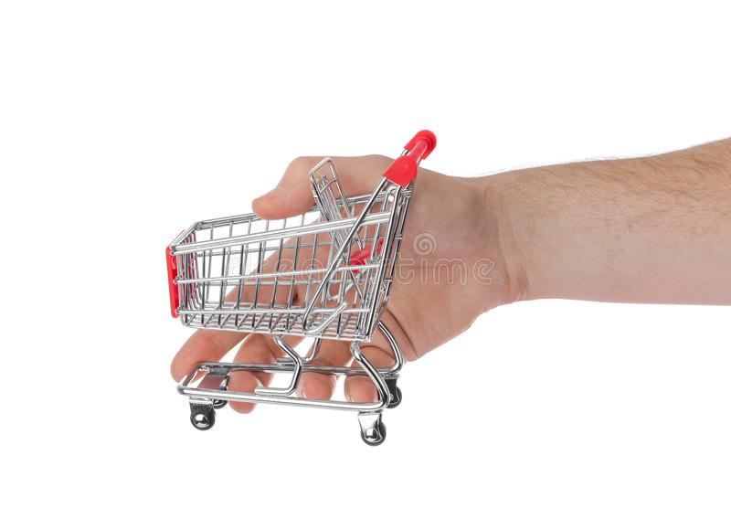 белизна тележки изолированная рукой ходя по магазинам стоковые фотографии rf
