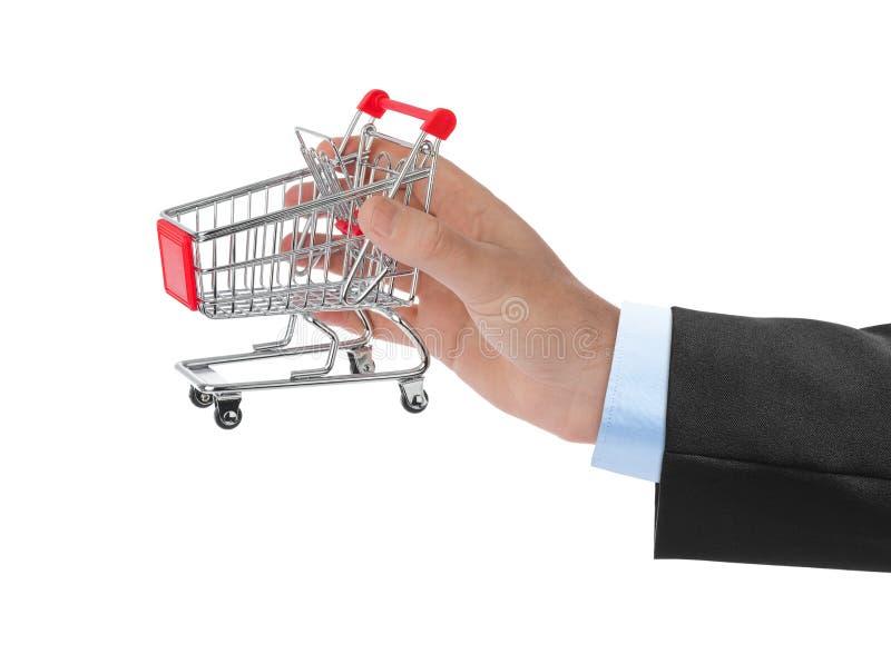 белизна тележки изолированная рукой ходя по магазинам стоковое фото rf