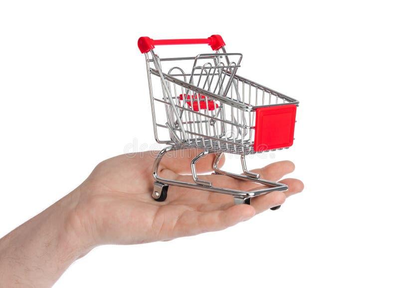 белизна тележки изолированная рукой ходя по магазинам стоковая фотография