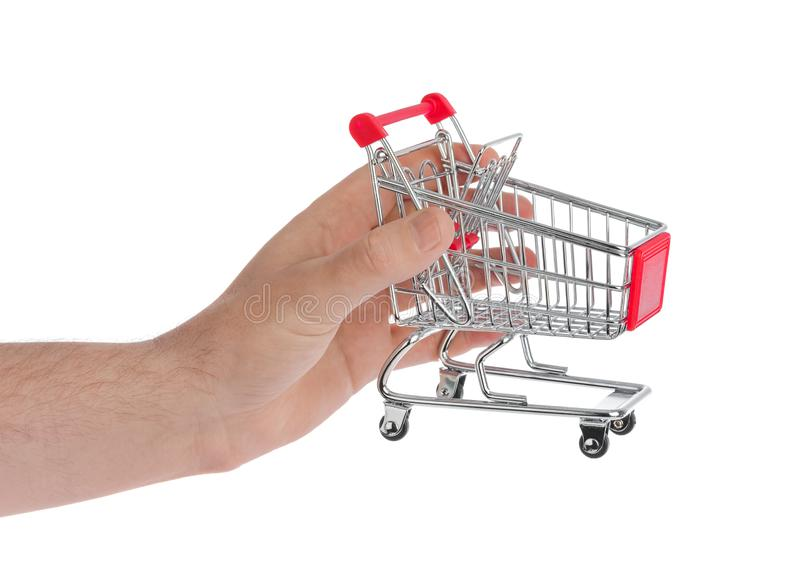 белизна тележки изолированная рукой ходя по магазинам стоковое фото