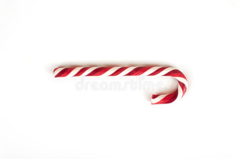 белизна тросточки конфеты предпосылки изолированная рождеством стоковое изображение