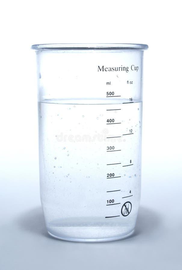 белизна чашки измеряя стоковые фото