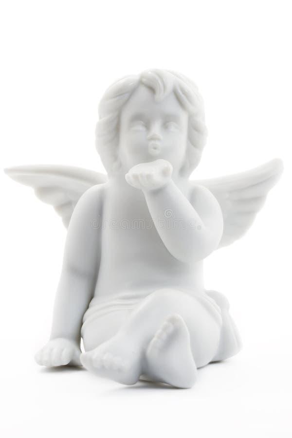 белизна figurine рождества ангела целуя стоковое фото rf