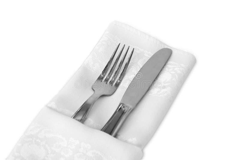 белизна linen салфетки flatware стоковая фотография rf