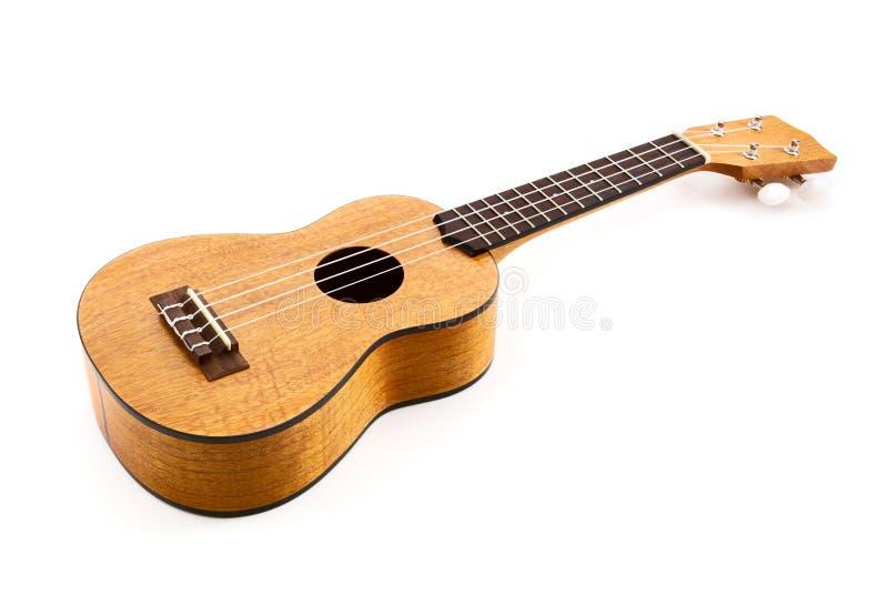 белизна ukulele предпосылки стоковые фотографии rf