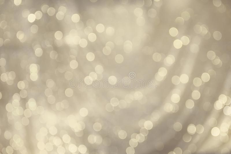 Белое и серое bokeh сверкнает картины яркого блеска абстрактные для предпосылки рождества стоковое изображение rf