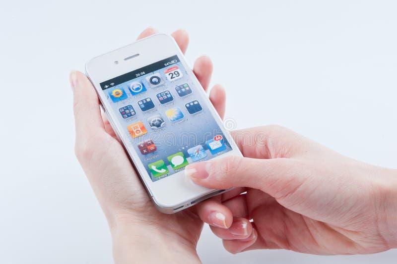 Белое iphone 4S стоковая фотография