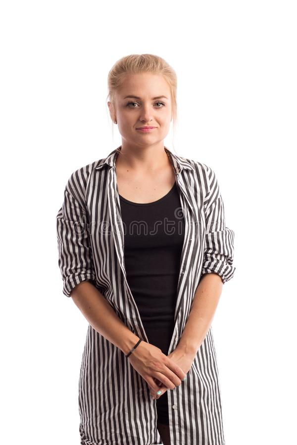 Белокурая девушка в striped рубашке и черных чулках стоковое изображение