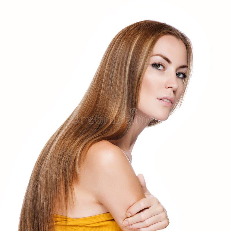 Белокурая женщина Hair.Beautiful с прямыми длинними волосами стоковые фотографии rf