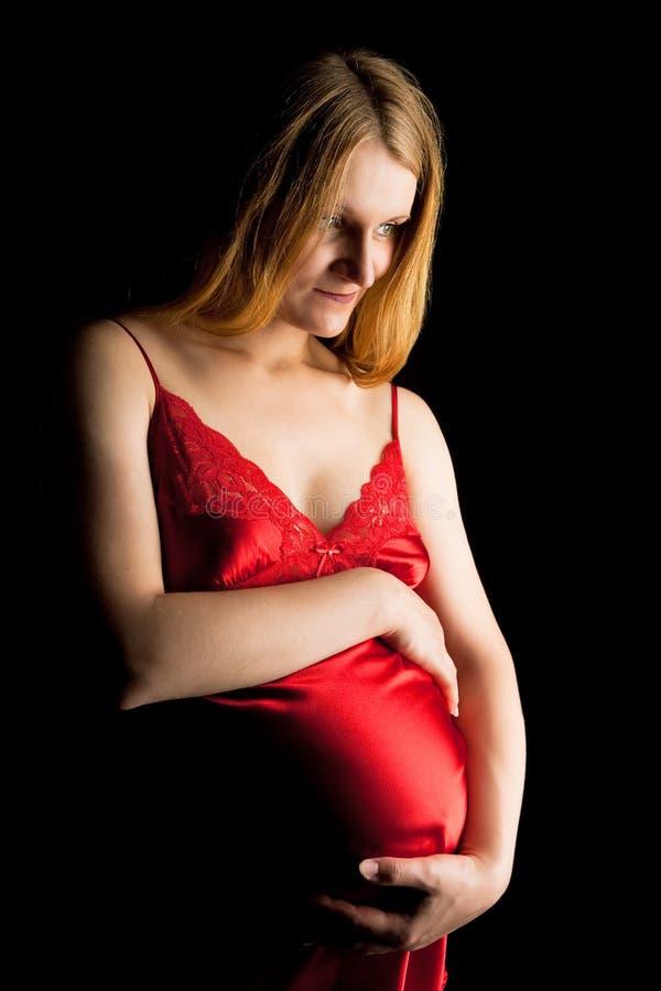 белокурая милая беременная женщина стоковое фото