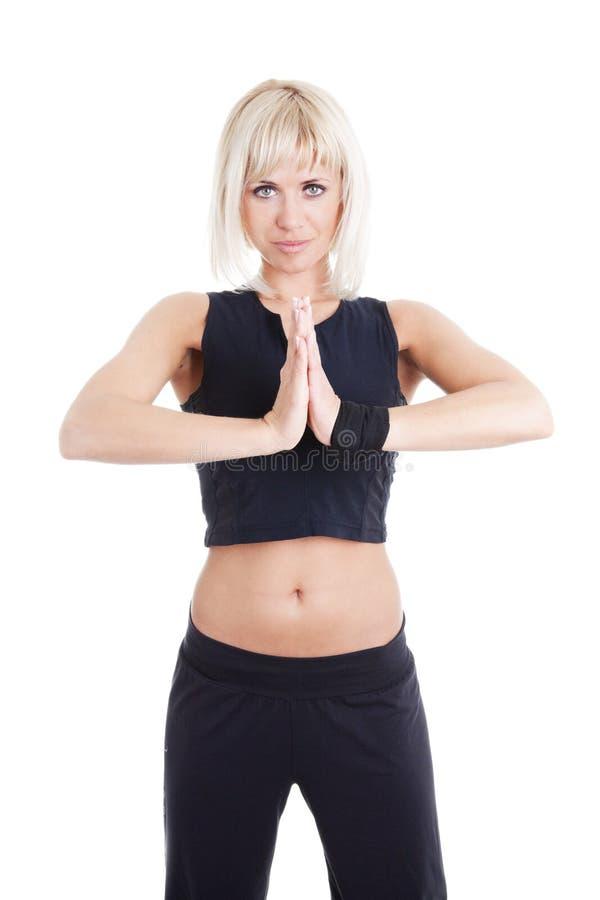 белокурая пригодность над женщиной тренировки белой стоковое фото rf