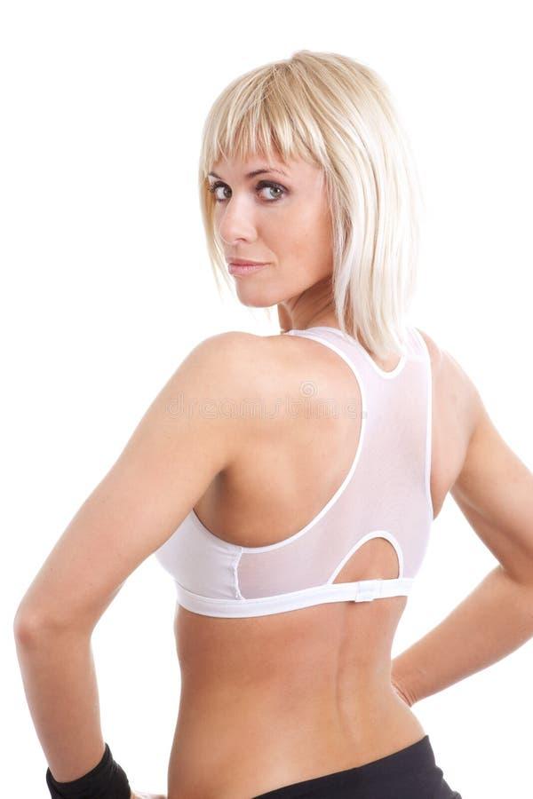 Белокурая пригодность тренировки женщины над белизной стоковое изображение rf