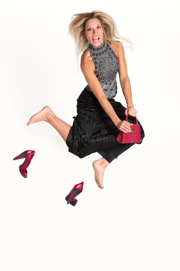 белокурая скача женщина стоковые изображения rf