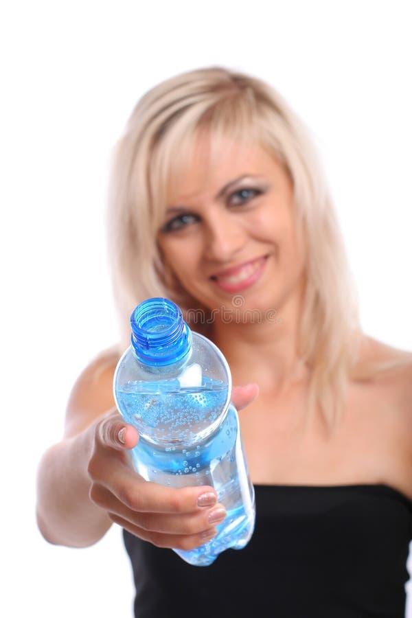 Белокуро с бутылкой стоковое фото rf