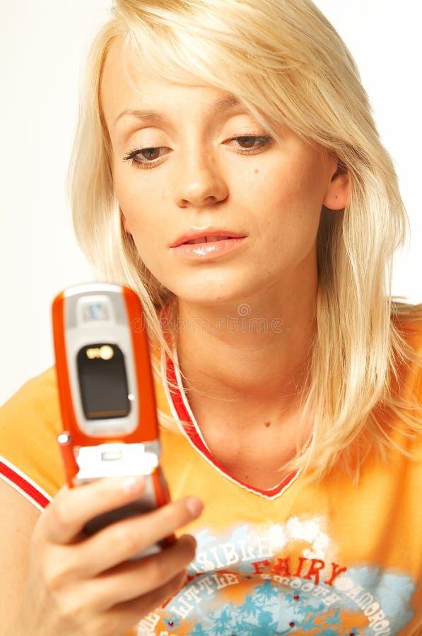 Download белокурый телефон девушки клетки Стоковое Изображение - изображение насчитывающей коммерсантка, модель: 489045