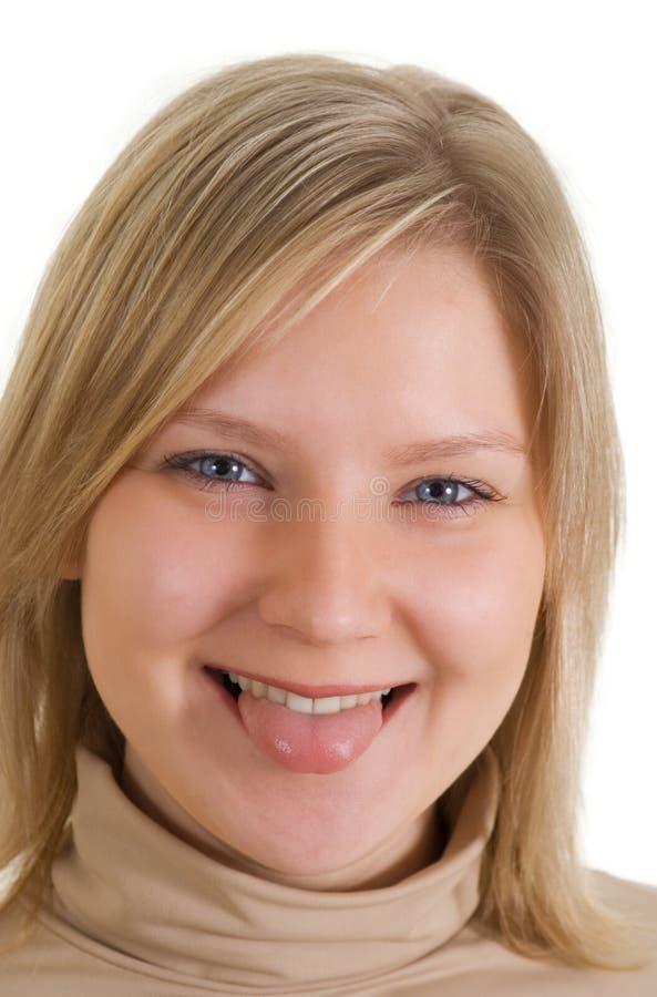 белокурый усмехаться девушки стоковое фото rf