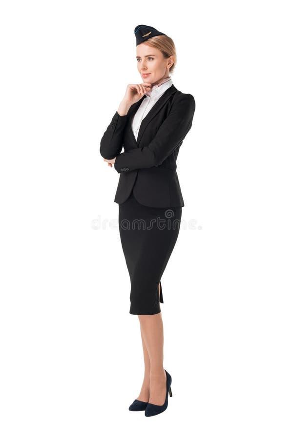 Белокурый stewardess в усмехаться формы стоковые фото