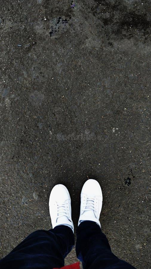 Белые ботинки стоковая фотография rf