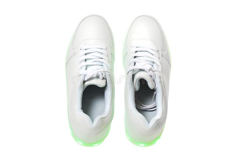 Белые sneackers со светлой подошвой приведенной стоковые изображения