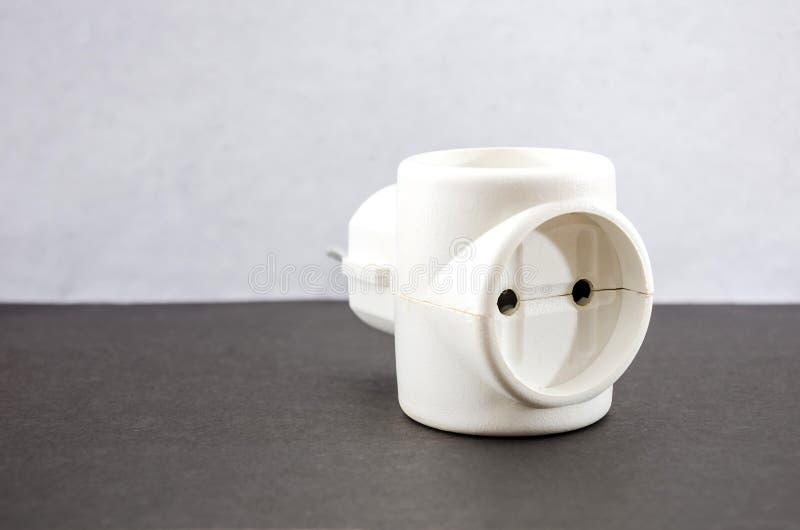 Белый переходник на серой предпосылке стоковое фото rf