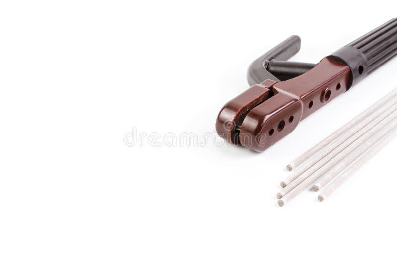 Белый покрытый электрод дуговой сварки для стального и коричневого держателя стоковое изображение rf