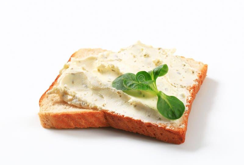 Белый хлеб с распространением сыра стоковое фото rf