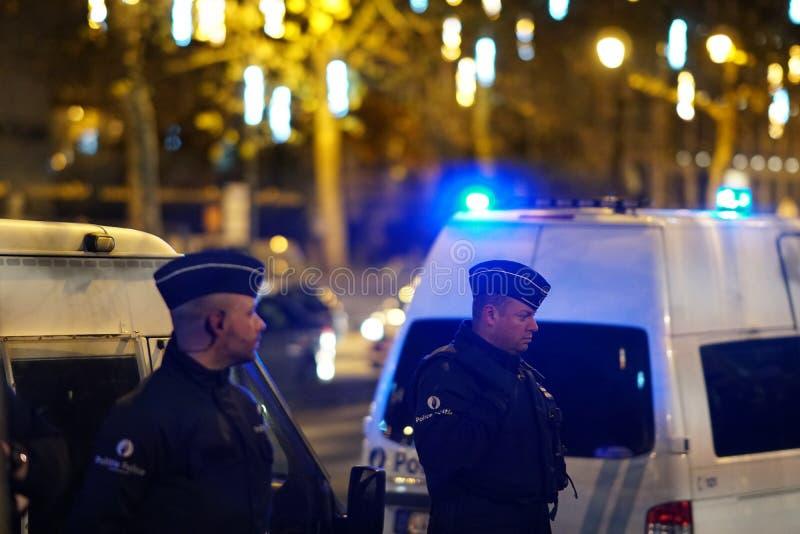 Бельгийские полицейскии на ноче стоковые изображения rf