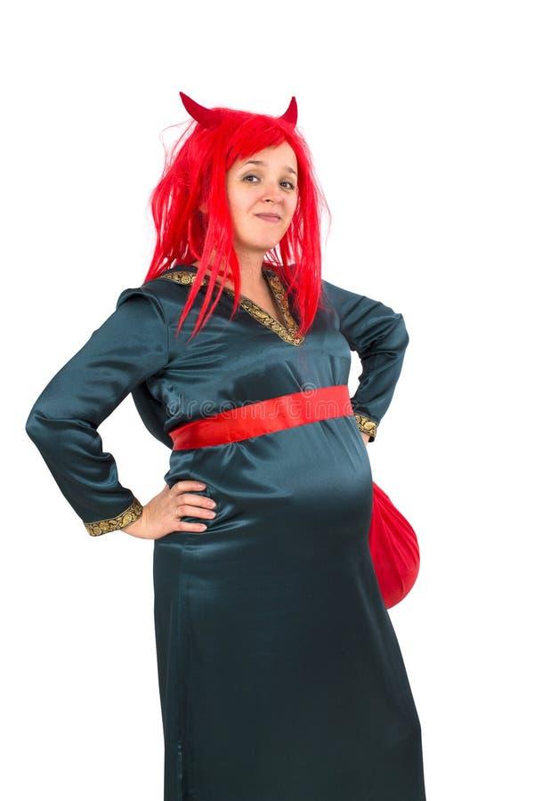 Беременная женщина в костюме масленицы стоковое фото